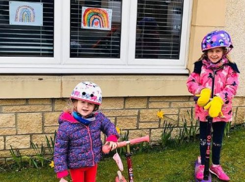 Mhairi, 5, and Zoe, 3 have spent their time creating rainbows for their local rainbow trails