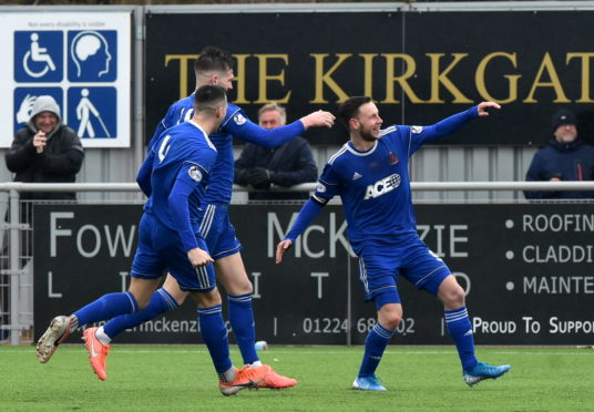 Megginson (no9) celebrating after scoring to make it 2-0. Picture by Kenny Elrick