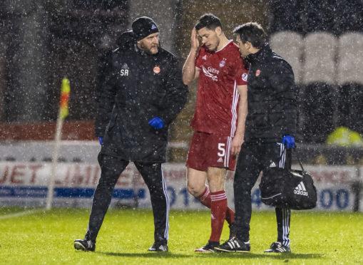 Scott McKenna after injuring his hamstring at St Mirren.