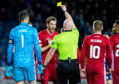 Ash Taylor is booked for a handball in the box, with Kilmarnock scoring the resulting penalty.