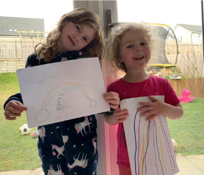 Sophie, 5  and Ava, 4 with their paintings