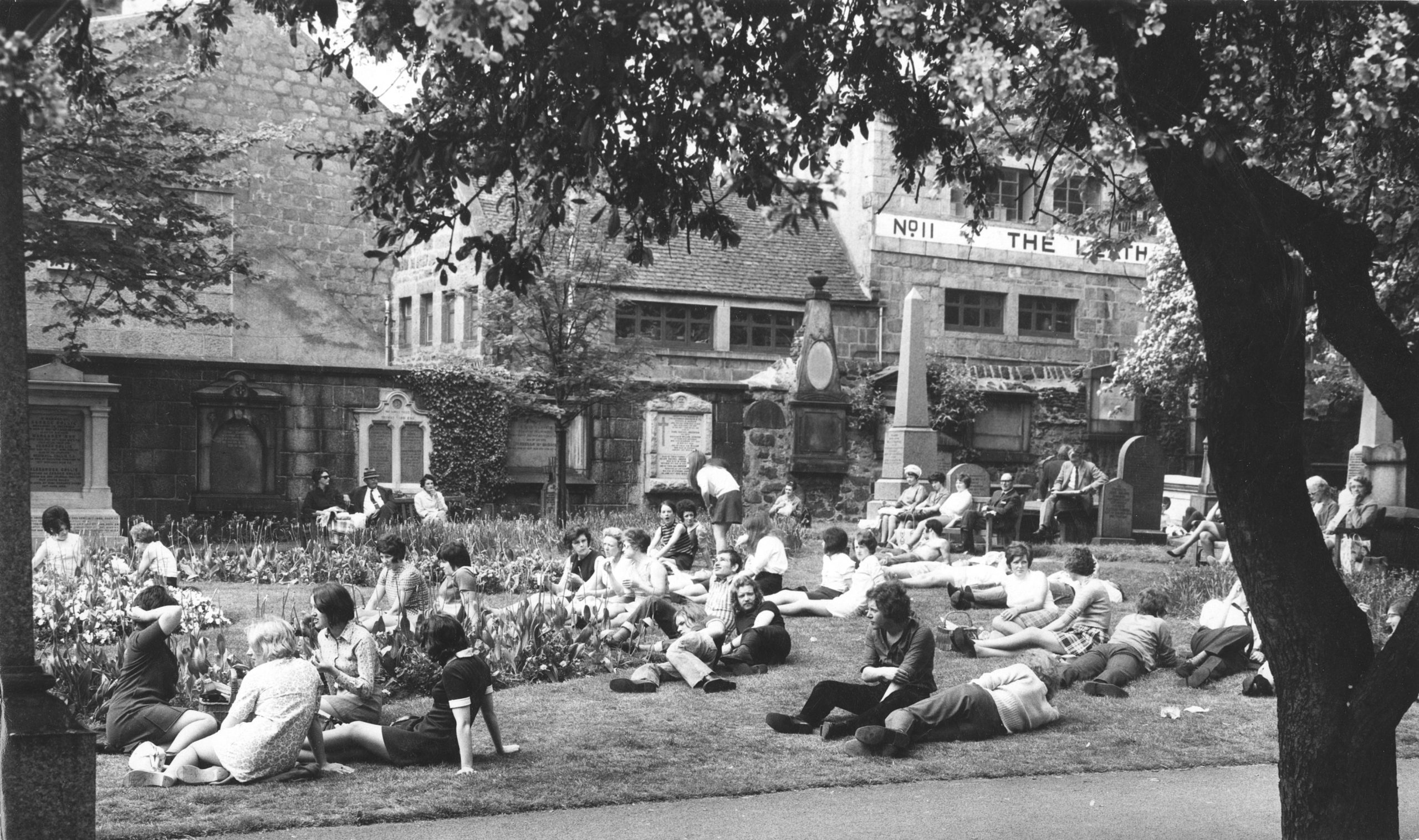 City workers make the most of the sunshine during their lunch-hour in St Nicholas churchyard