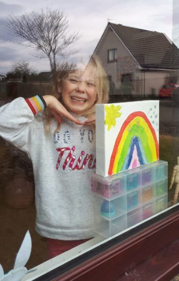 Six-year-old Stephanie and her rainbow
