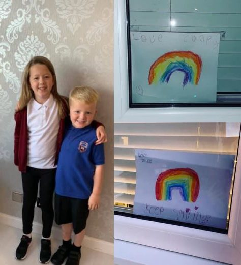 Zara, 8, and Cooper, 5, with their drawings