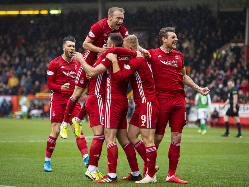 Aberdeen's players come together to celebrate Andrew Considine's goal.