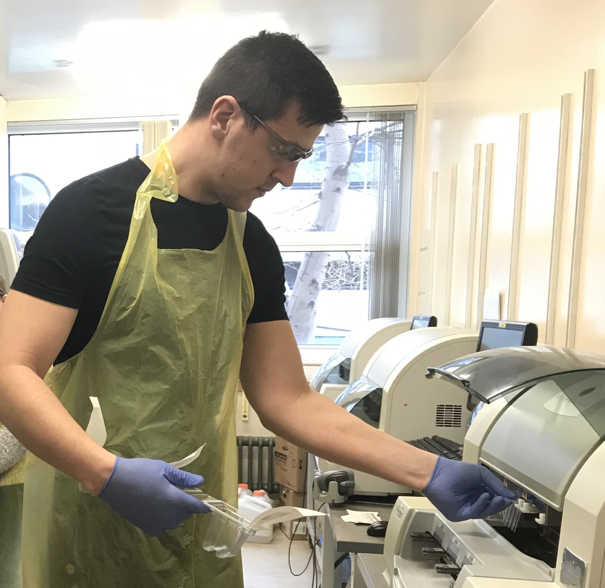 An NHS Grampian staff member with a testing machine