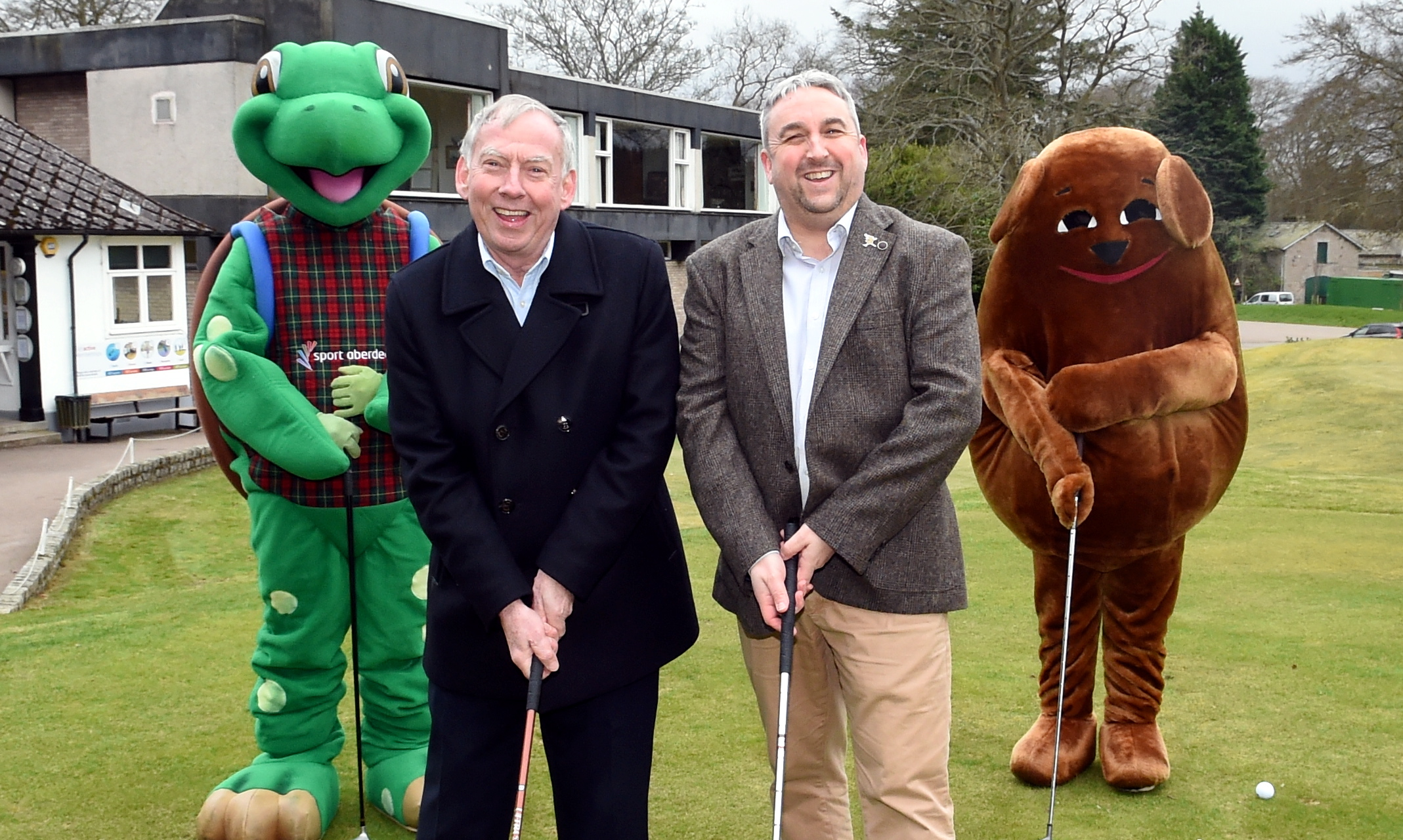 The Active Aberdeen Partnership's Tony Dawson, left, and the ARCHIE Foundation's David Downie, with the Sport Aberdeen and ARCHIE Foundation mascots when the event was announced. Picture by Jim Irvine