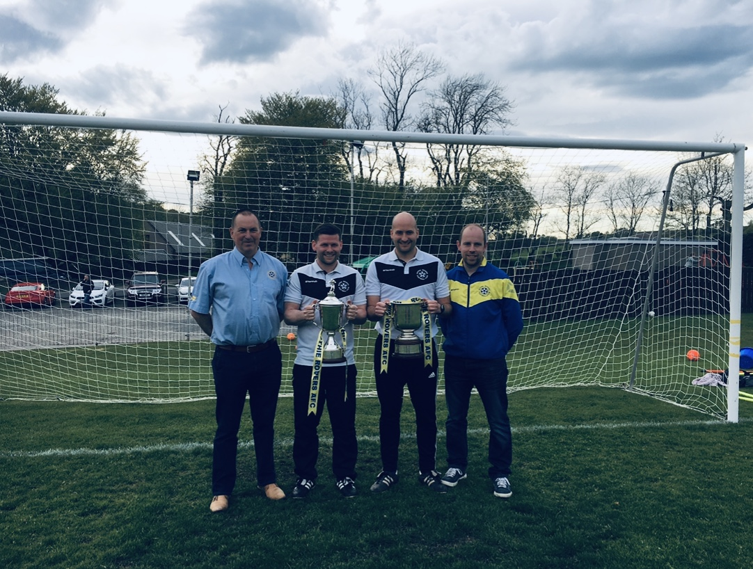 From left, Rothie Rovers chairman Brian Cormack, manager Kevin Beaton, vice-chairman Bryan McKinnon and secretary Sandy Rattan with the North of Scotland Cup and Premier Trophy.