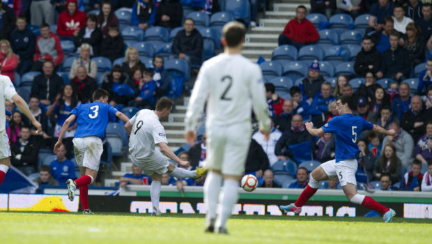 Peterhead's Rory McAllister (9) scores his side's second goal of the game.