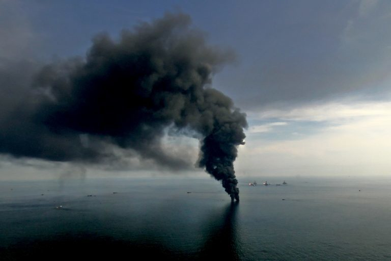 Smoke billows from controlled oil burns near the site of the BP Plc Deepwater Horizon oil spill in the Gulf of Mexico off the coast of Louisiana on June 19, 2010.