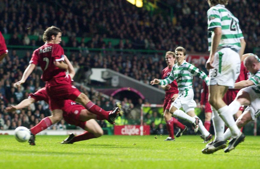 John Hartson (right) reduces the deficit for Celtic.
