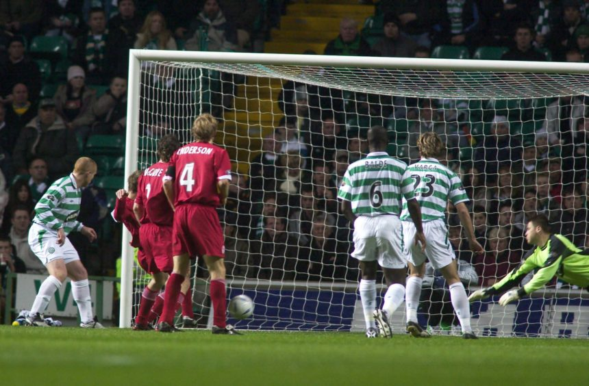 Darren Mackie (partially hidden) silences the Celtic fans by putting Aberdeen into the lead.