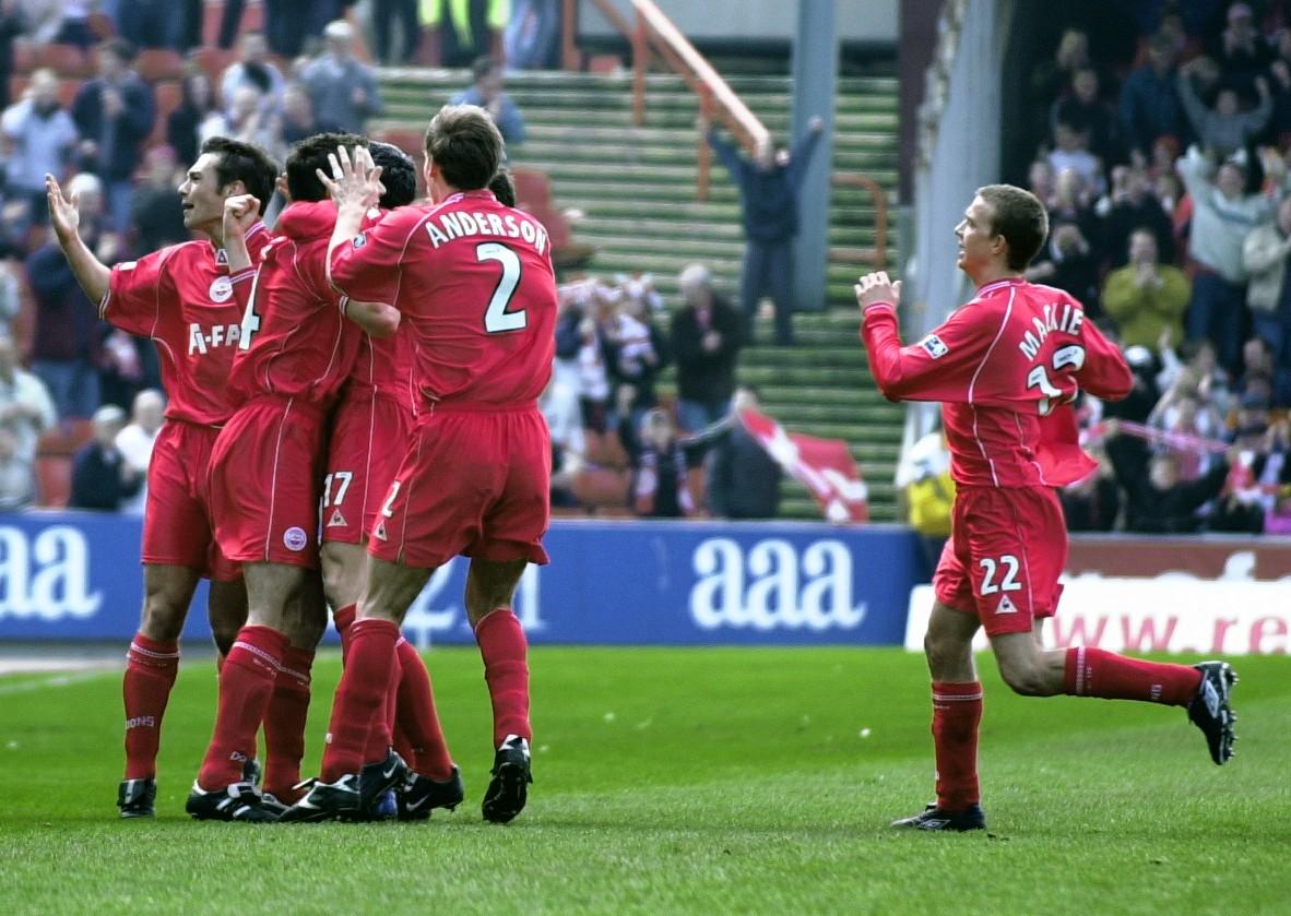Aberdeen's players celebrate.