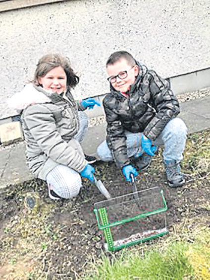 Leon, 10 and Shayla, 7, have been spending their mornings doing school work and afternoons in the garden and doing crafts