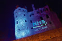 Huntly Castle is lit up in blue to say thank you to the NHS