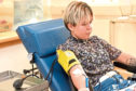 Blood donor Rusita Stankunaite donates at Aberdeen Blood Donor Centre on Foresterhill Road
