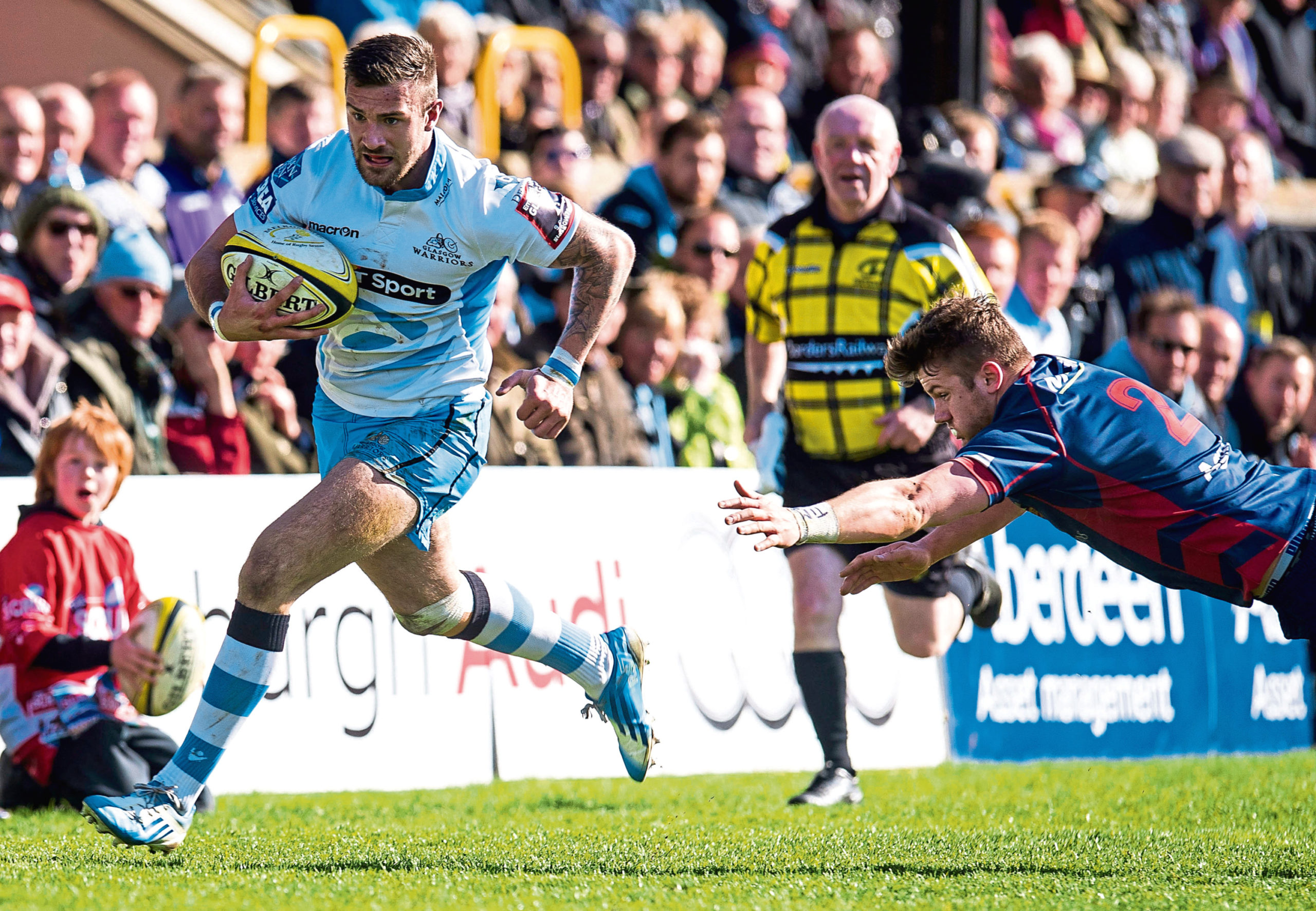 Glasgow Warriors' Rory Hughes (left) in possession at the Melrose 7s tournament.