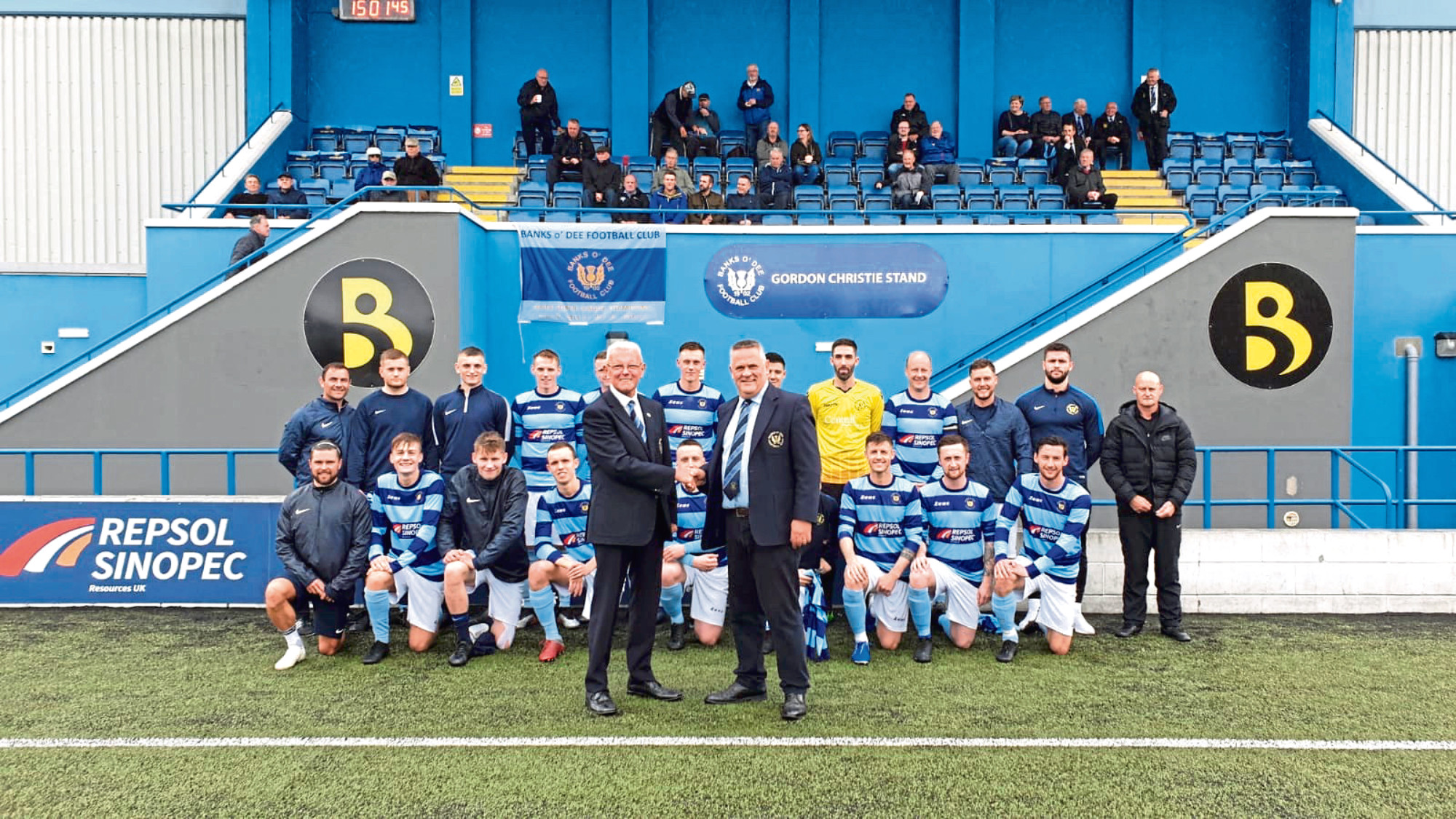 President Brian Winton, right, is pictured with vice president Gordon, with the Dee first team in the background.
