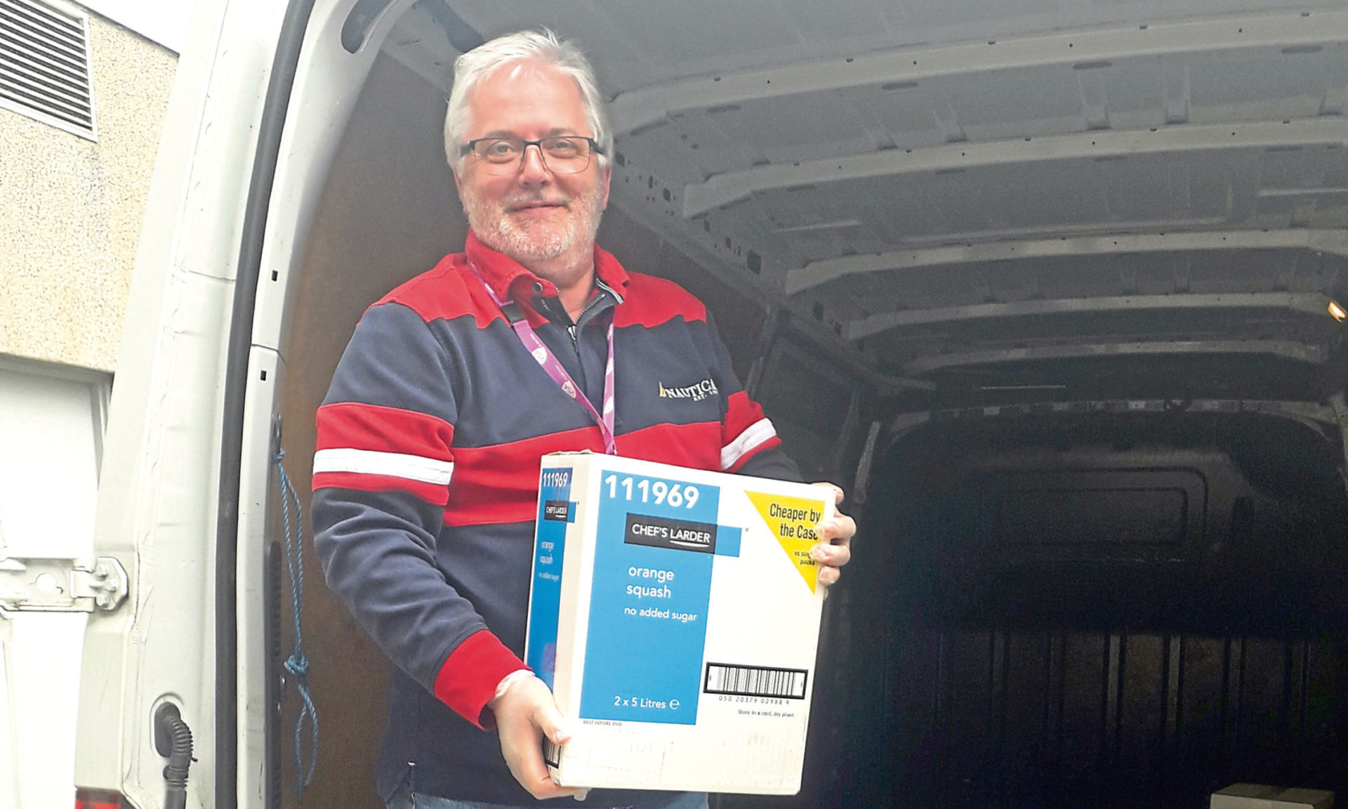 VSA's chief executive Kenneth Simpson receives the BP donations which include PPE, iPads, Kindles and basics such as pasta and drinks