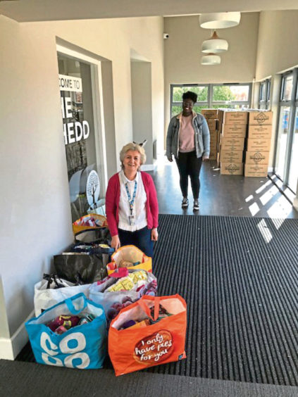 Sheena Lonchay and Adom Otoo with deliveries for ARI