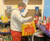 Boxer Lee McAllister sorting food bank donations to deliver to families