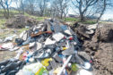 People in Aberdeen are being urged to report fly tipping