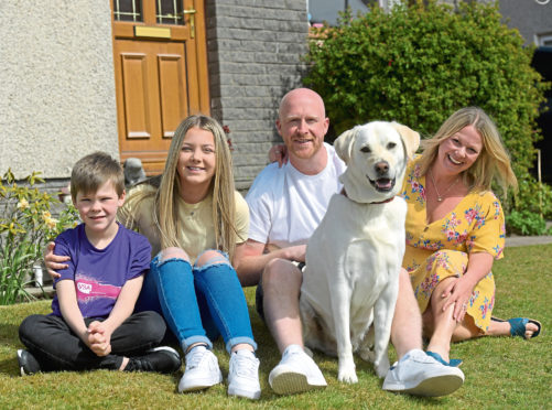Mac Johnston with, from left, sister Kennedy, dad Terry, mum Jodie and Marley the dog, is aiming to raise cash for Easter Anguston Farm