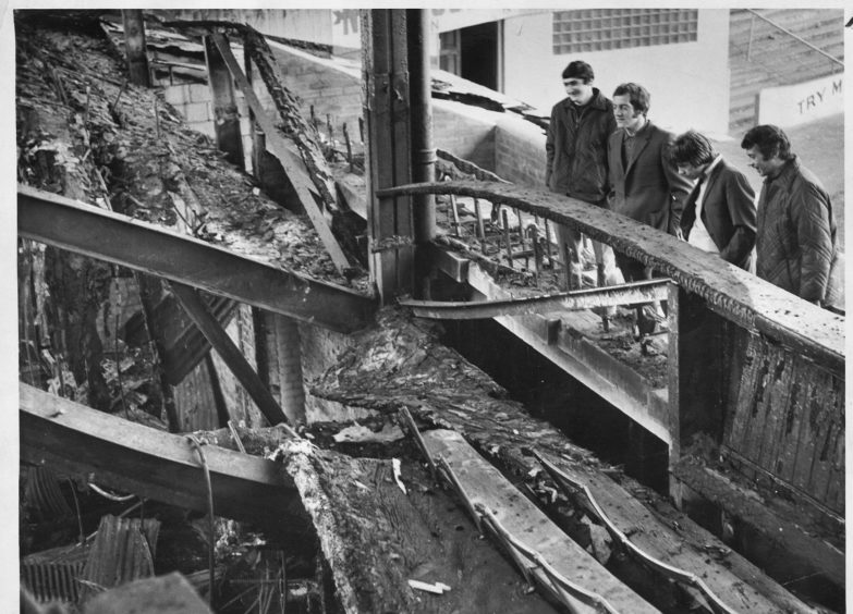 Dons players, from left, Jim Hermiston, Andy Geoghegan, Arthur Graham and Tommy McMillan view the damage in 1971.