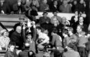 Dons captain Martin Buchan holds the Scottish Cup aloft for the fans at Hampden.