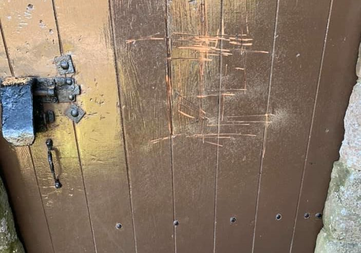 The damaged door at Dunnottar Castle