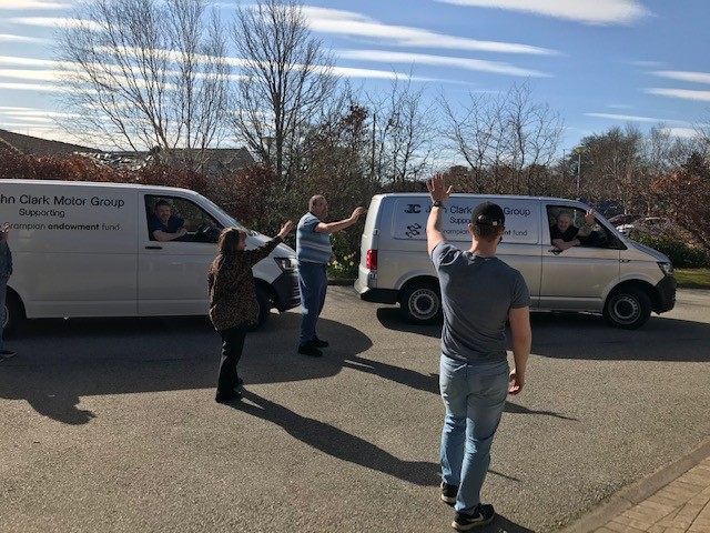Volunteers wave off the vans on their way to deliver the boxes to Dr Gray's Hospital