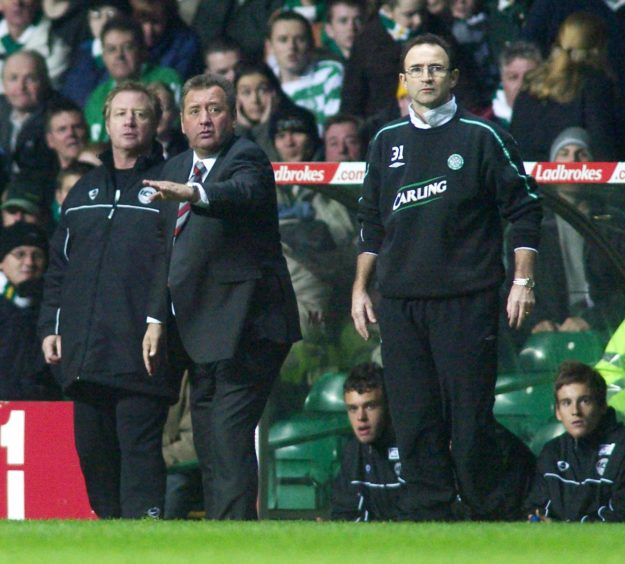 All eyes on the action for Celtic boss Martin O'Neill (right) and Dons management duo Jimmy Calderwood (centre) and Jimmy Nicholl.