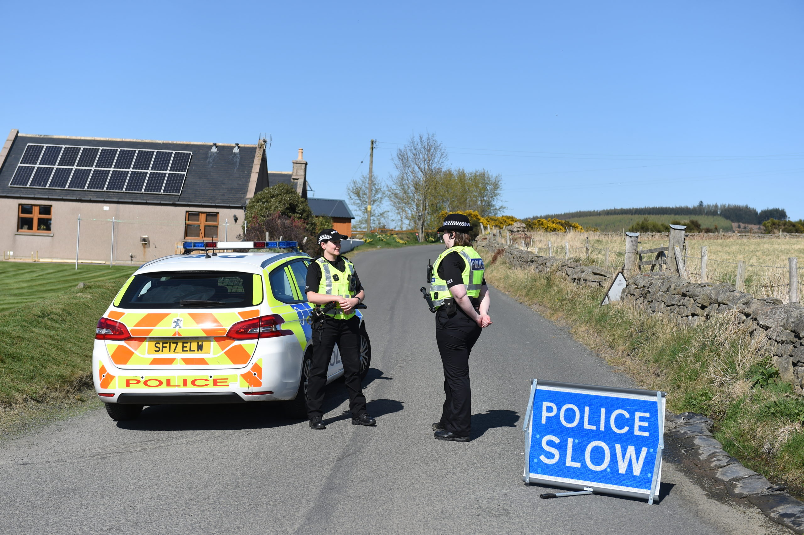 Police at the scene of the crash on the B979