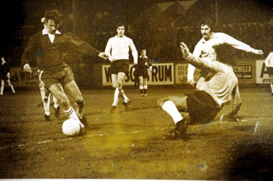 Division One. Season 1972-73. Aberdeen 3  Dundee 1. Zoltan Varga waltzes round the Dundee keeper to score Aberdeen's second goal.