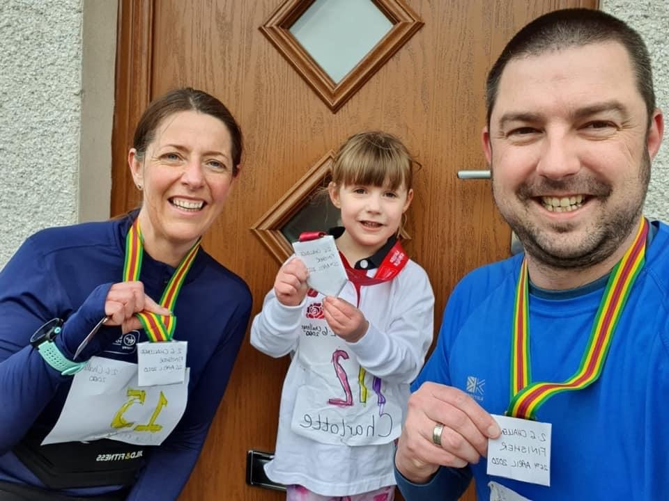 Marianne, Charlotte & Fred Evans ran 2.6 miles and created their own race bib numbers