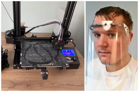 Joe, right, and his 3D printer he has been using to build the face masks