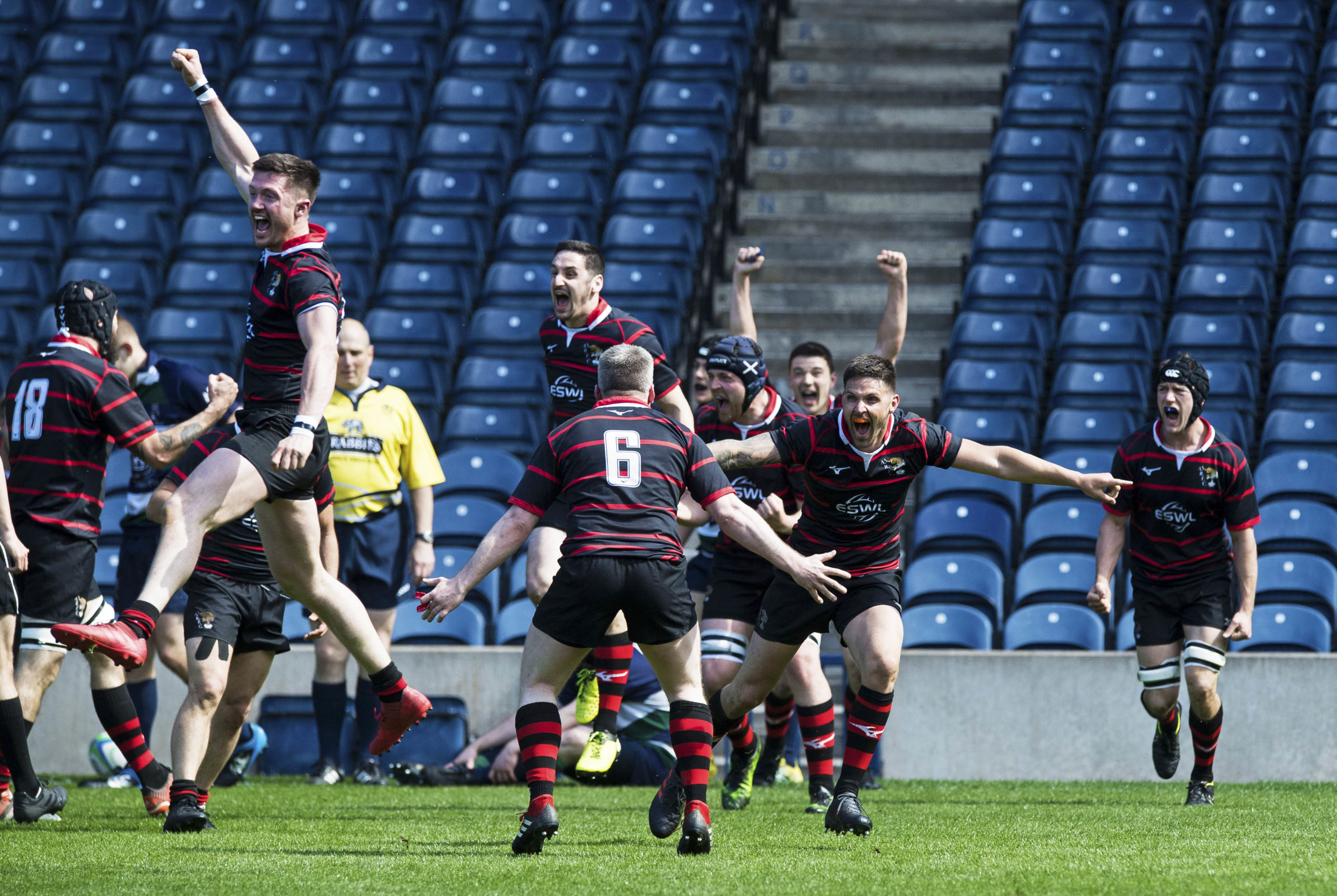 The Aberdeenshire players celebrate the result at full time of the National Bowl.