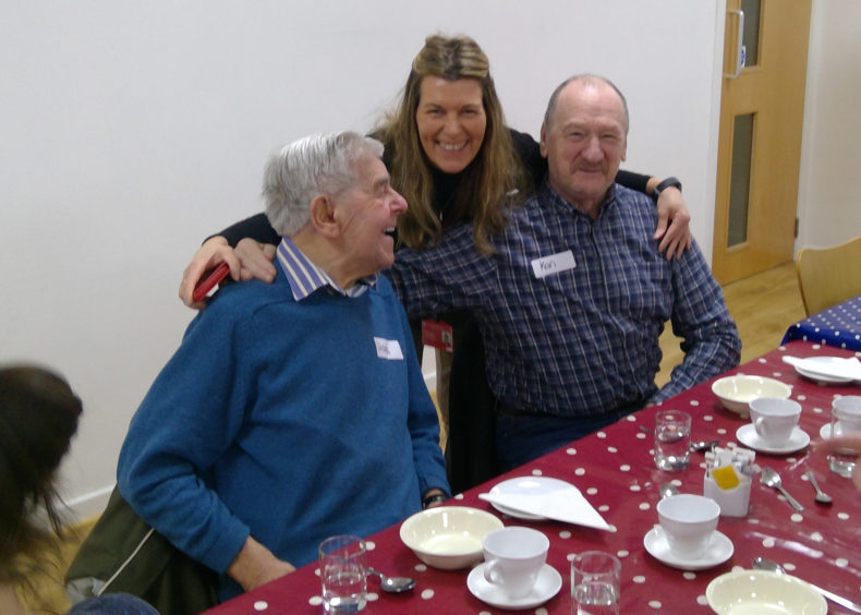 Ingrid Penny from Scottish War Blinded with two veterans at a pre-lockdown lunch club
