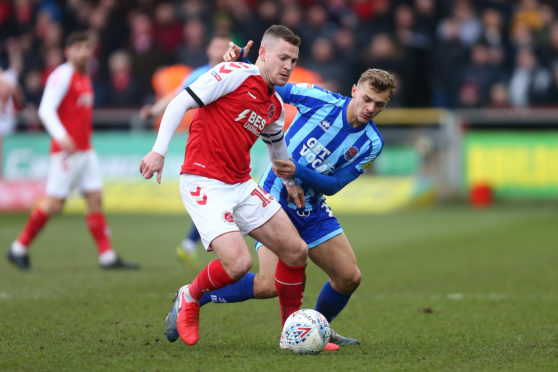 Paul Coutts, left, of Fleetwood Town.