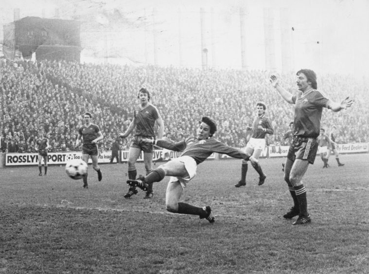 Rangers' opening goal against Aberdeen at Pittodrie as young John MacDonald nips in between the waiting Aberdeen defence to fire the ball in to the net.