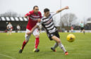 A young Scott McKenna in action for Ayr.