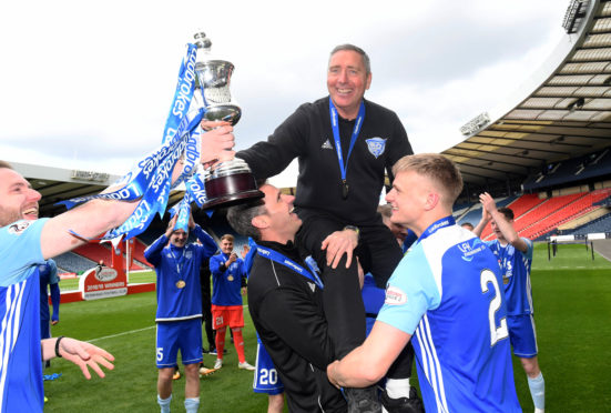 Peterhead manager Jim McInally lifts the Ladbrokes League 2 trophy.