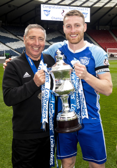 Jim McInally and captain Rory McAllister.
