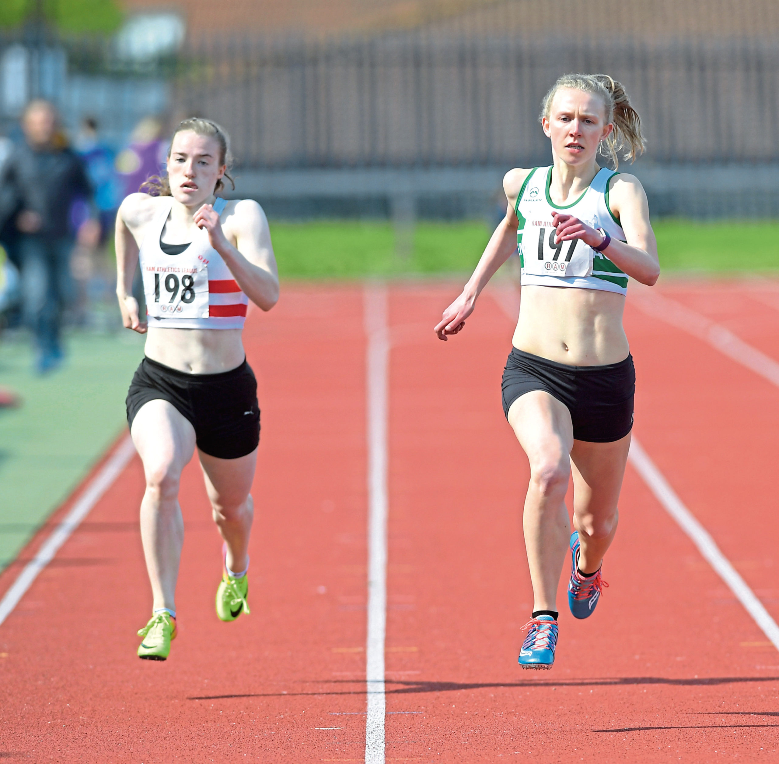 RAM Athletics League meeting at Aberdeen Sports Village. Women's 200 metres. 2nd place (198) Rebecca Matheson and winner (197) Roisin Harrison. CR0009947 02/06/19 Picture by KATH FLANNERY