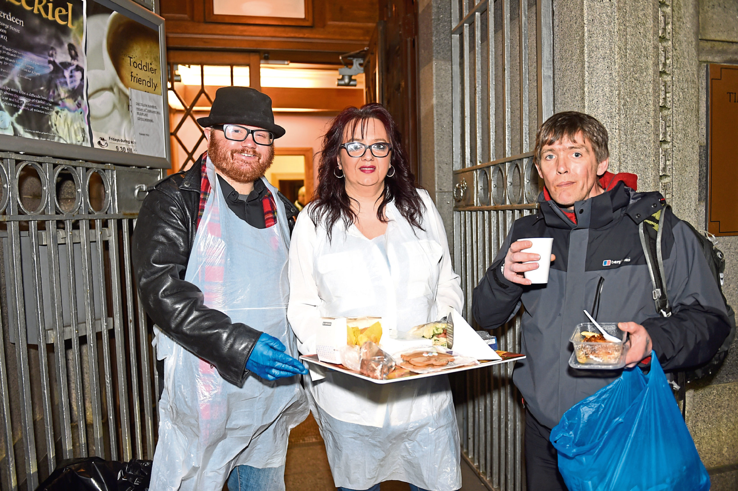 Street Friends' Justin Ritchie and Michelle Houghton with dinner for Davey Bruce outside Aberdeen Church of Christ​