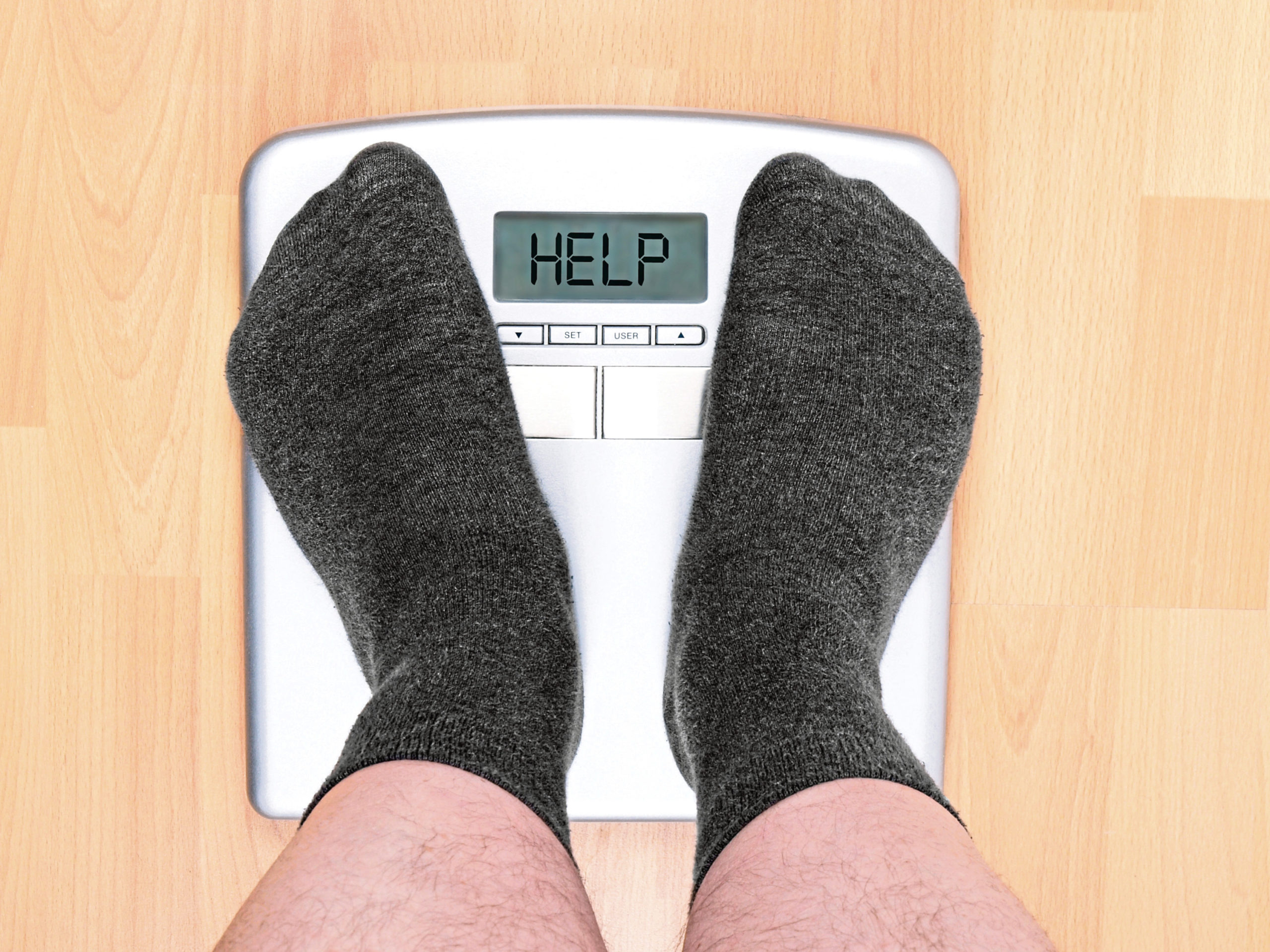 overweight man on personal scales; Shutterstock ID 206253880; Purchase Order: -