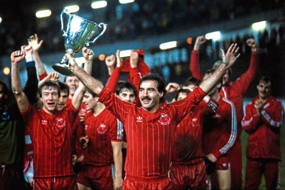 Aberdeen captain Willie Miller holds aloft the Cup winners Cup