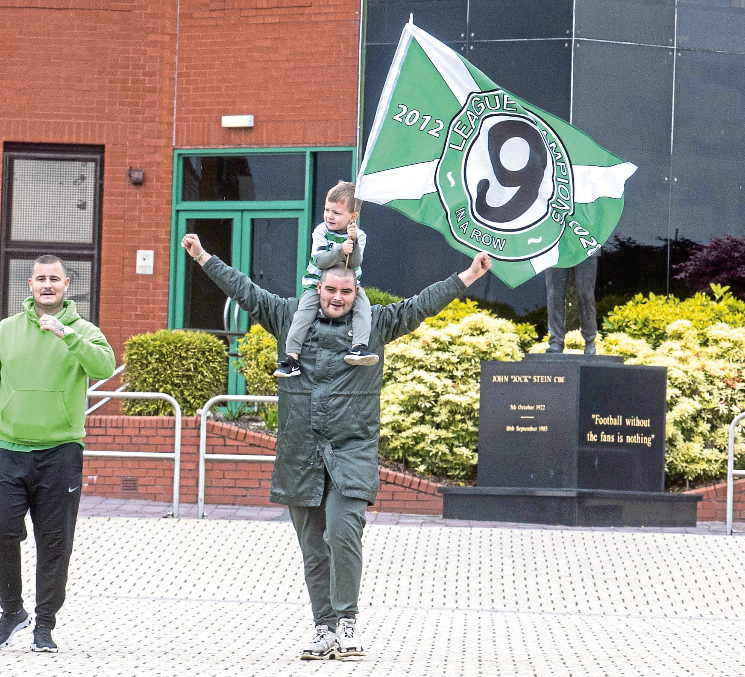 Celtic fans celebrate being awarded the Premiership title outside Parkhead yesterday.