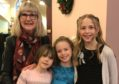 Kathleen with her grandchildren Sarah, Lucy and Alice