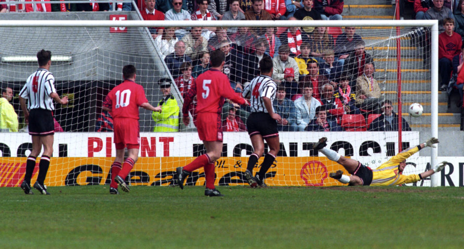 Craig Robertson (out of frame) scores a consolation goal for Dunfermline.